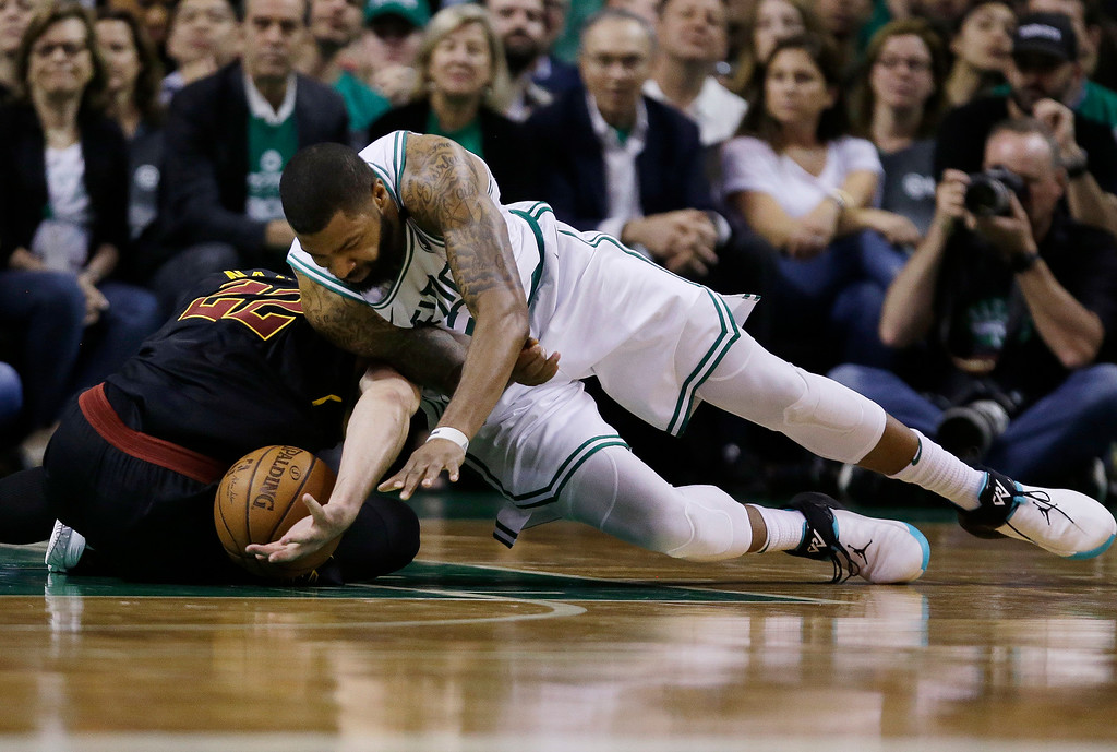 . Boston Celtics forward Marcus Morris (13) dives for a loose ball next to Cleveland Cavaliers forward Larry Nance Jr., left, during the fourth quarter of Game 5 of the NBA basketball Eastern Conference finals Wednesday, May 23, 2018, in Boston. (AP Photo/Charles Krupa)