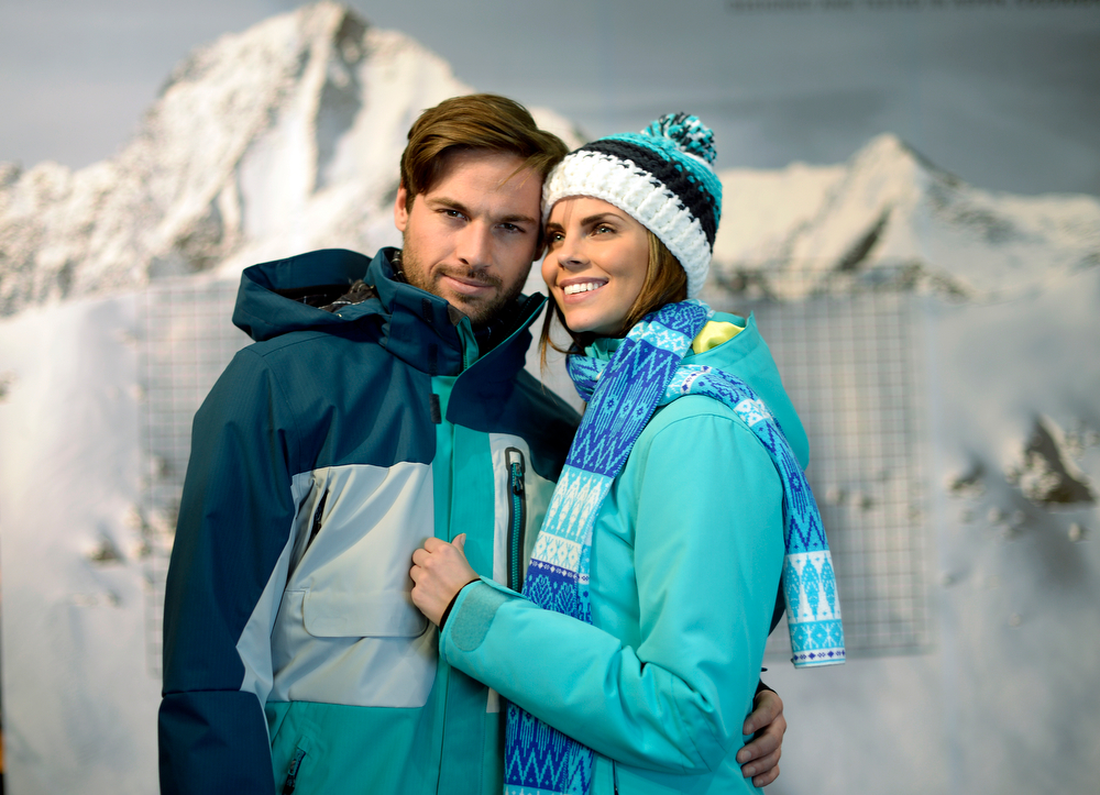 . Two models in a jackets and hat from Aspen-based Obermeyer  during a visit to the Snowsports Industries America  Snow Show at the Colorado Convention Center in Denver on Thursday, January 30, 2014. (Denver Post Photo by Cyrus McCrimmon)