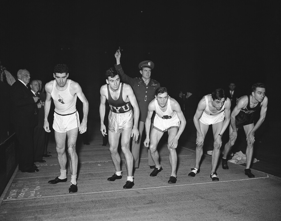 . Runner�s toe the starting line as Capt. Louis S. Zamperini (standing behind) prepares to start the field in the special invitation mile run named in his honor at the IC4A indoor track and field championships on March 2, 1946 in Madison Square Garden, New York. The entries are (left to right) Tommy Quinn, New York Athletic Club; Leslie MacMitchell, of New York, William J. McGuire, Jr., 69th regiment A.A.; Marcel Hansenne, French track star, and Forest C. Efaw, of Okla., unattached. MacMitchell won the race. The mile run was named in Zamperini�s honor a year ago when he was listed as �officially dead� by the War Department. (AP Photo/MZ)