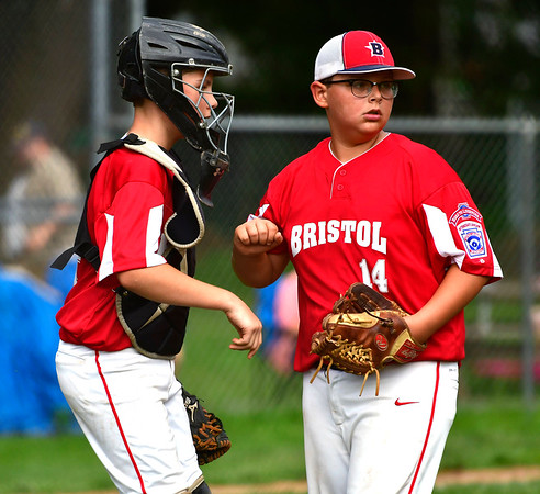 6/25/2019 Mike Orazzi | Staff Forestville's Tyler Ryan (28) and Dom Guzzardi (14) during Tuesday's baseball game with Wallingford in Bristol.