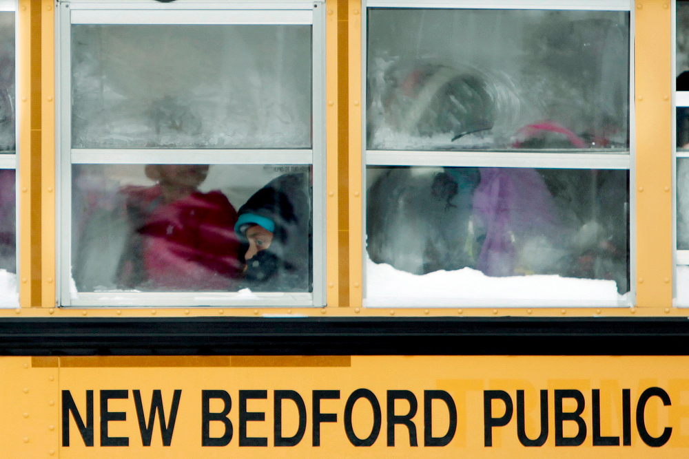 . A student can be seen trying to stay warm as seen through the the frosty windows of the school bus on Thursday Jan. 23, 2014 in New Bedford, Mass. The area is in the grip of frigid weather.  (AP Photo/Standard Times,  PETER PEREIRA)
