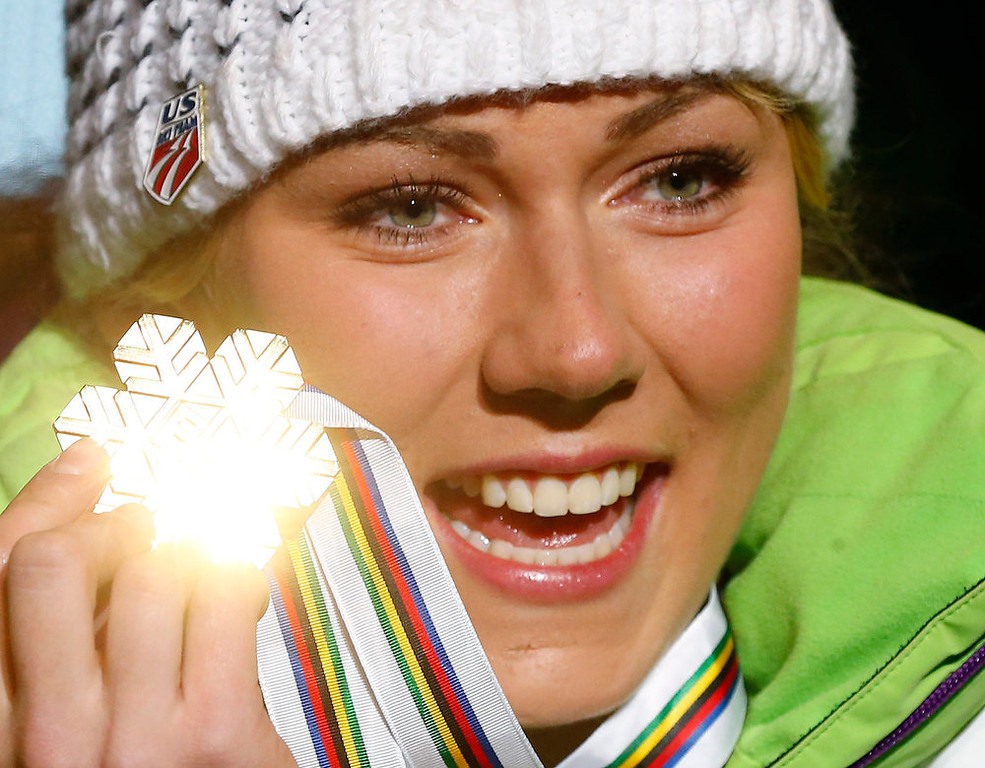 . Mikaela Shiffrin of the U.S. shows her gold medal during the medal ceremony of the women\'s slalom event at the FIS alpine skiing world championships in Schladming February 16, 2013. REUTERS/Dominic Ebenbichler