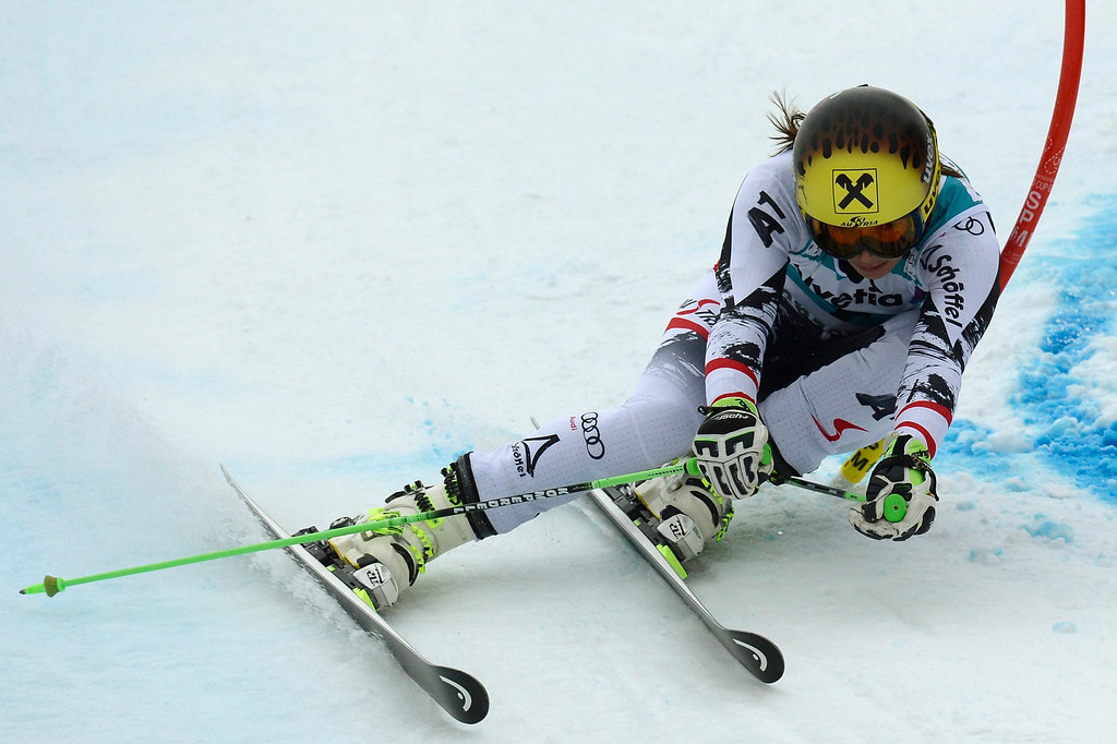 . Anna Fenninger of Austria speeds down the course in the first run during the women\'s Giant Slalom race at the FIS Alpine Skiing World Cup finals, in Parpan-Lenzerheide, Switzerland, 16 March 2014.  EPA/PETER SCHNEIDER