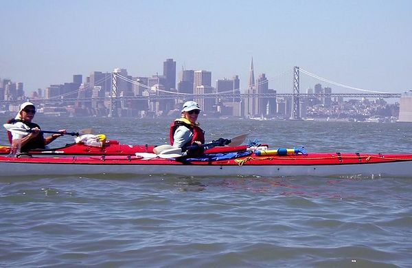 Susan Belmont sillhouetted against the city skyline.  I think this is the first time she has paddled 15.5 miles.  Yay!!!!