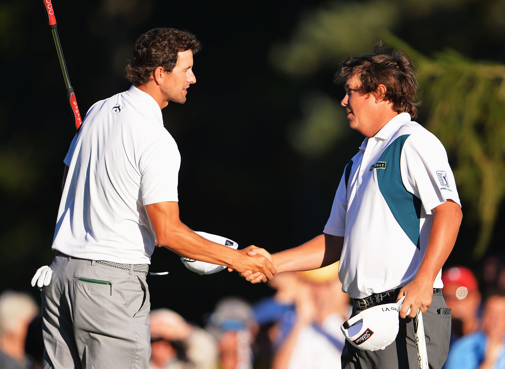 . ROCHESTER, NY - AUGUST 10: Adam Scott of Australia shakes hands with Jason Dufner of USA on the 18th hole during the third round of the 95th PGA Championship on August 10, 2013 in Rochester, New York.  (Photo by Stuart Franklin/Getty Images)