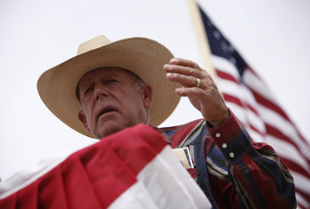 """. <p><b> Nevada rancher Cliven Bundy sparked outrage last week when he suggested that these people would be better off living as slaves � </b> <p> A. African Americans <p> B. Mexican Americans <p> C. The Tea Party folks camped out on his land <p><b><a href=\'http://www.twincities.com/news/ci_25629426/nevada-rancher-bundy-condemned-racist-remarks\' target=\""""_blank\""""> LINK </a></b> <p>    (AP Photo/Las Vegas Review-Journal, John Locher)"""