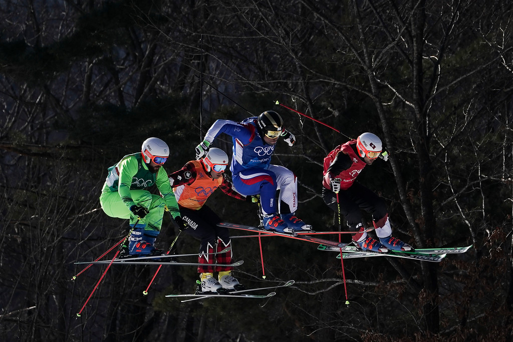 . From left; FilipFlisar, of Slovenia, DaveDuncan, of Canada, ArnaudBovolenta, of France, and Armin Niederer, of Switzerland, run the course during the men\'s ski cross small final at Phoenix Snow Park at the 2018 Winter Olympics in Pyeongchang, South Korea, Wednesday, Feb. 21, 2018. (AP Photo/Felipe Dana)