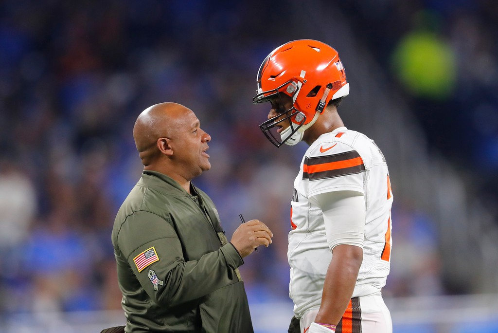 . Cleveland Browns head coach Hue Jackson talks with quarterback DeShone Kizer during the first half of an NFL football game against the Detroit Lions, Sunday, Nov. 12, 2017, in Detroit. (AP Photo/Paul Sancya)