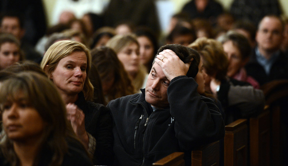 . Mourners gather inside the St. Rose of Lima Roman Catholic Church at a vigil service for victims of the Sandy Hook School shooting December 14, 2012 in Newtown, Connecticut. Twenty-seven people are dead, including 20 children, after a gunman identified as Adam Lanza in news reports opened fire in the school. Lanza also reportedly died at the scene.  (Photo by Andrew Gombert-Pool/Getty Images)