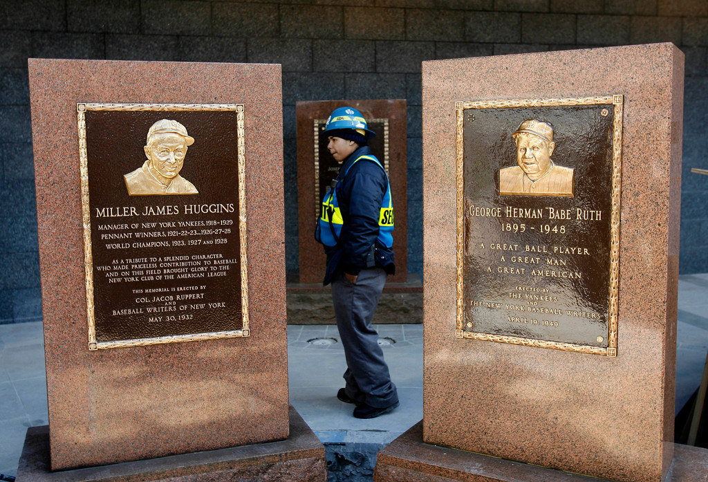 . A security guard keeps watch over Monument Park in the new Yankee Stadium in New York, Wednesday, Feb. 25, 2009.   The Babe Ruth monument, right, was moved into place today.  (AP Photo/Seth Wenig)