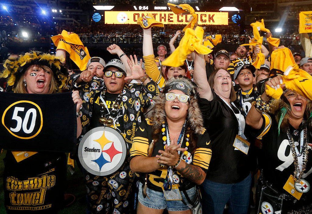 . Pittsburgh Steelers fans cheer during the first round of the NFL football draft, Thursday, April 26, 2018, in Arlington, Texas. (AP Photo/Michael Ainsworth)
