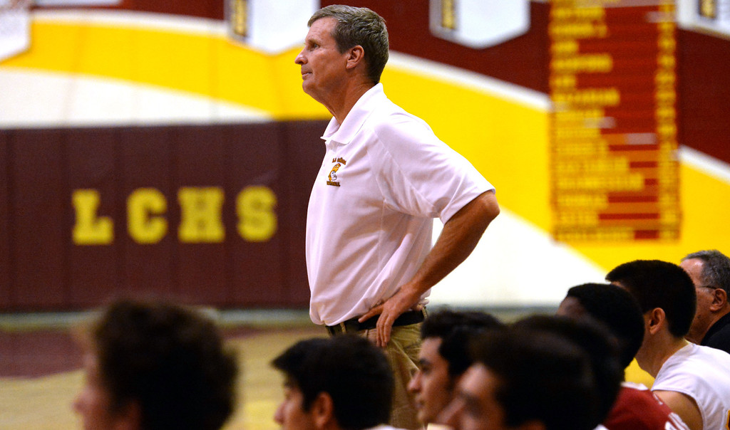 . La Canada head coach Tom Hofman looks towards the scoreboard in the fourth quarter as they defeated La Salle 73-62 for coach Hofman\'s 600th win during a prep basketball game at La Canada High School in La Canada, Calif., on Friday, Jan. 10, 2014. Hofman record is 600 wins and 186 losses since becoming varsity head coach in the 1986-87 season. (Keith Birmingham Pasadena Star-News)