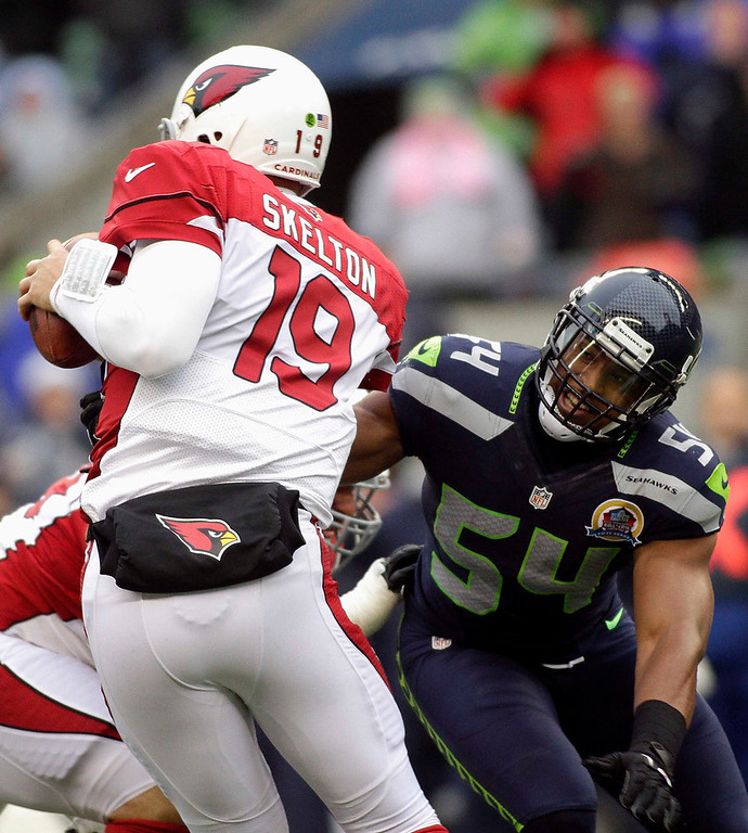 . Arizona Cardinals starting quarterback John Skelton is pressured by Seattle Seahawks\' Bobby Wagner (54) during the first quarter of their NFL football game in Seattle, Washington, December 9, 2012. REUTERS/Robert Sorbo