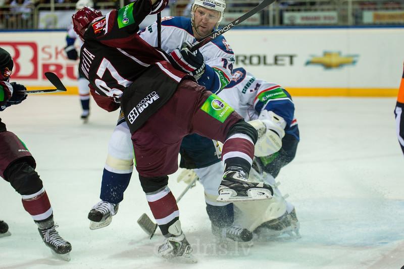 Malenkikh Vladimir (14) stops Andris Dzerins (25) in front of the goal