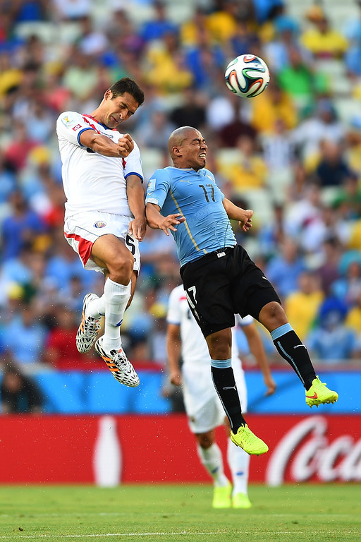 . Celso Borges of Costa Rica and Egidio Arevalo Rios of Uruguay go up for a header during the 2014 FIFA World Cup Brazil Group D match between Uruguay and Costa Rica at Castelao on June 14, 2014 in Fortaleza, Brazil.  (Photo by Laurence Griffiths/Getty Images)