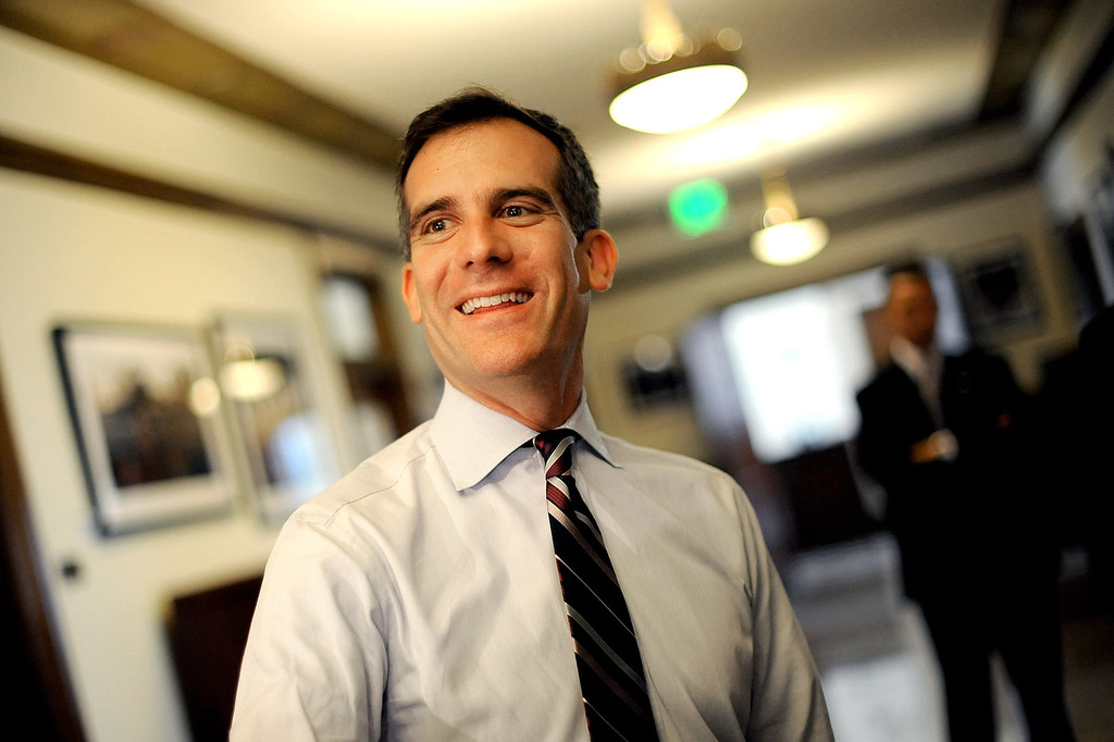 . Mayor Eric Garcetti lets out a smile whie waiting to meet with a constituent Monday during his first day as Mayor of Los Angeles.   Garcetti held �office hours� at City Hall from 2-5 p.m., during which he met with Angelenos who have emailed requests for help from City Hall July 1, 2013.(Andy Holzman/Los Angeles Daily News)