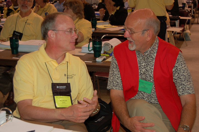 Bishop Michael Burk, Southeastern Iowa Synod, chats with Tom von Fischer.