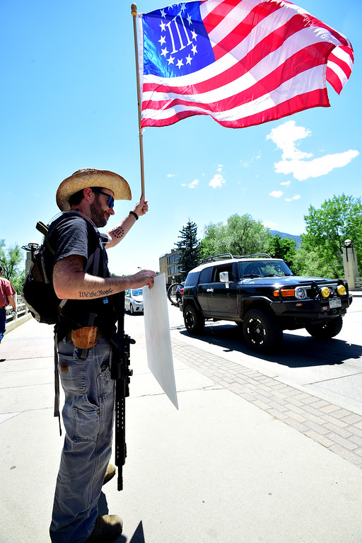 . Jason Boros, with his AR-15 and handgun demonstrate on Broadway during a Second Amendment rally in Boulder on Saturday.  He politely refused to do that.  For more photos and video go to dailycamera.com. Paul Aiken Staff Photographer