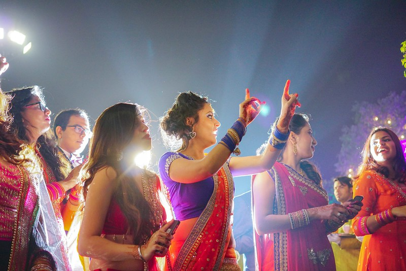 brides sister dancing on entry of baraat- wedding photo.jpg
