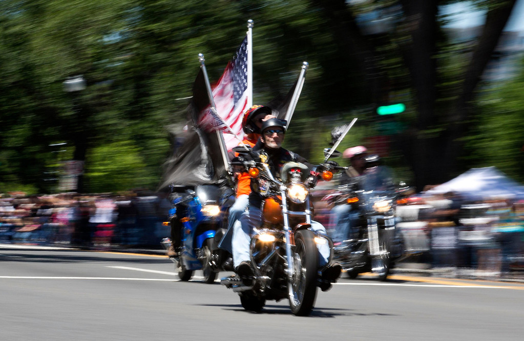 . A biker flies the American flag during the Rolling Thunder ride in Washington May 26, 2013. The 26th Annual Rolling Thunder is organised to show support for veterans past and present, and those who have fallen in war or missing in action. REUTERS/Joshua Roberts