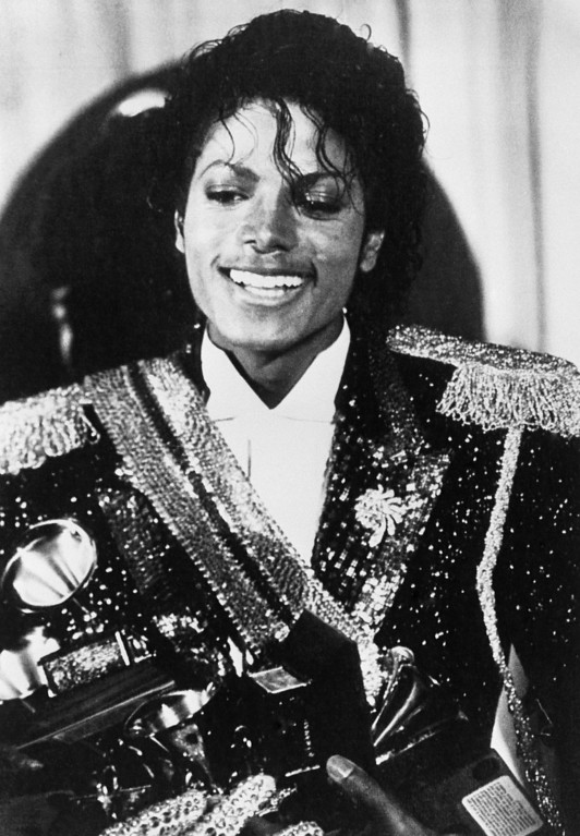 """. US superstar Michael Jackson holds several grammy awards he won at the 1984 Grammy awards ceremonies, 28 February 1984 in Los Angeles. His top award was the album of the year \""""Thriller\"""", which sold nearly 30 million copies. Jackson won the highest amount of awards during the presentation. (SUSAN RAGAN/AFP/Getty Images)"""