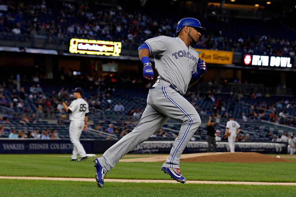 . Toronto Blue Jays designated hitter Edwin Encarnacion rounds first base after hitting a solo home run off of New York Yankees starting pitcher Luis Cessa during the first inning of a baseball game, Tuesday, Sept. 6, 2016, in New York. (AP Photo/Adam Hunger)