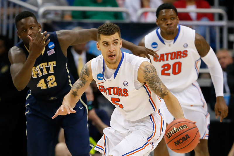 . Scottie Wilbekin #5 of the Florida Gators dribbles the ball against the Pittsburgh Panthers in the second half during the third round of the 2014 NCAA Men\'s Basketball Tournament at Amway Center on March 22, 2014 in Orlando, Florida.  (Photo by Kevin C. Cox/Getty Images)