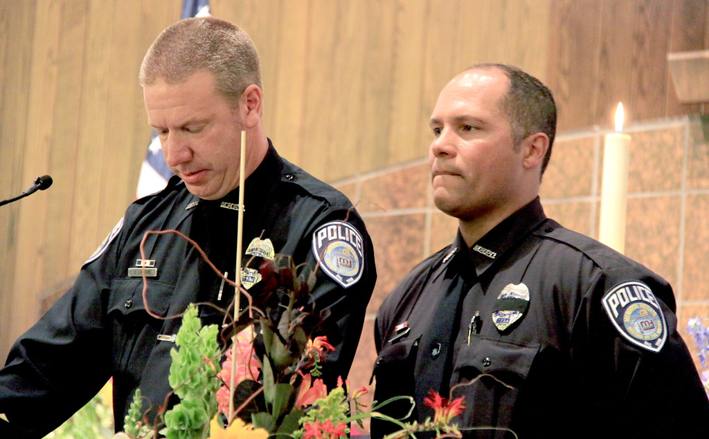 . Mendota Heights police officers John Larrive, left and Robert Lambert deliver a eulogy for officer Scott Patrick during his funeral service in St. Stephen\'s Lutheran Church in West St. Paul on Wednesday.  (Minnesota Department of Public Safety Pool Photo: Jen Longaecker)