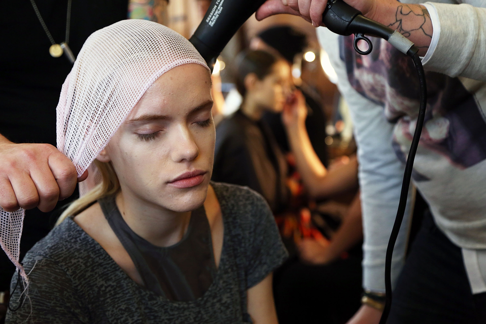 . A model prepares backstage for the Katie Gallagher fashion show at Mercedes-Benz Fashion Week Fall 2014 at The Highline Hotel on February 6, 2014 in New York City.  (Photo by Monica Schipper/Getty Images)