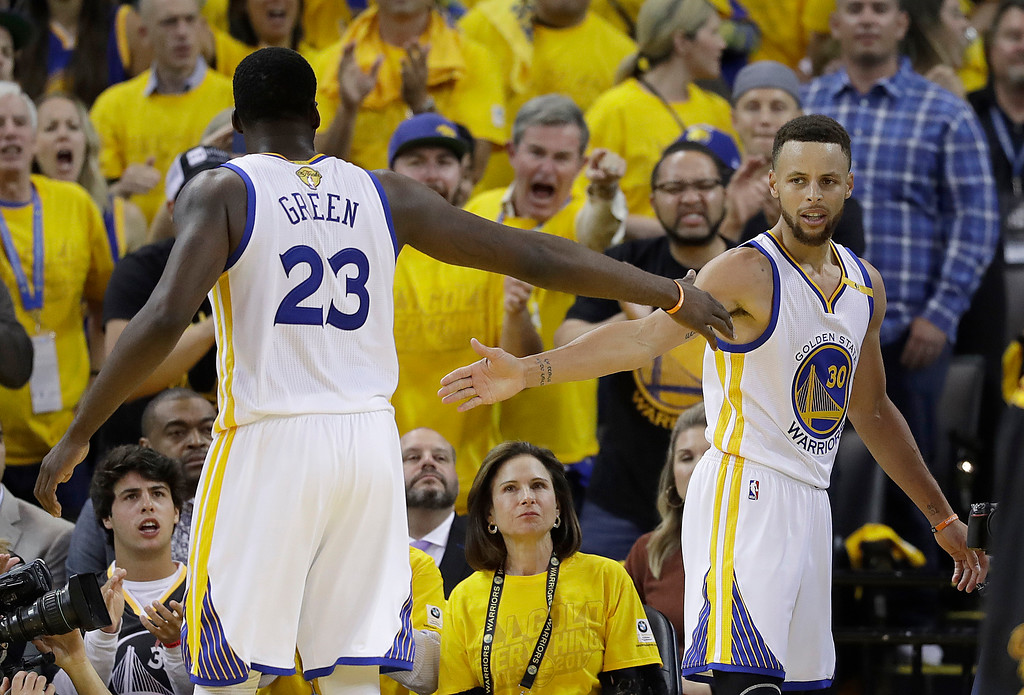 . Golden State Warriors forward Draymond Green (23) and guard Stephen Curry (30) celebrate during the second half of Game 5 of basketball\'s NBA Finals against the Cleveland Cavaliers in Oakland, Calif., Monday, June 12, 2017. (AP Photo/Marcio Jose Sanchez)