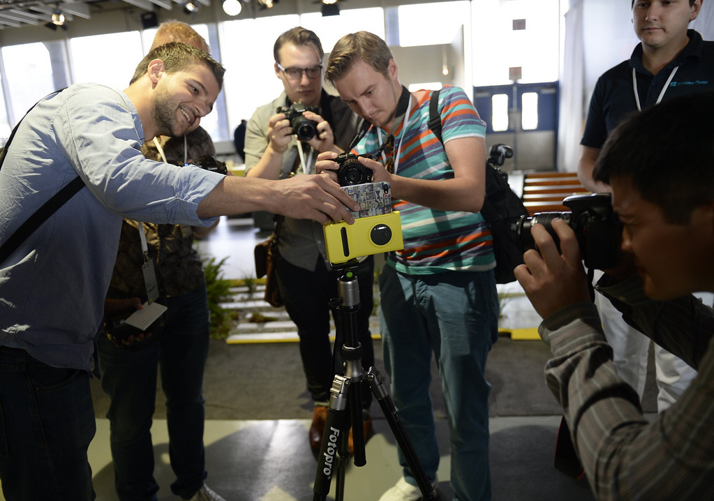 . Members of the press photograph the Nokia Lumia 1020, a Windows Phone with a 41-megapixel camera after its unveiling in New York City July 11, 2013. AFP PHOTO / TIMOTHY  CLARY/AFP/Getty Images