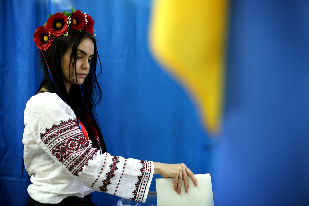. A woman casts her vote in a polling booth on May 25, 2014 in Kiev, Ukraine. The Ukrainian Presidential elections, taking place today, are widely viewed as crucial to taming instability in the eastern part of the country.  (Photo by Dan Kitwood/Getty Images)
