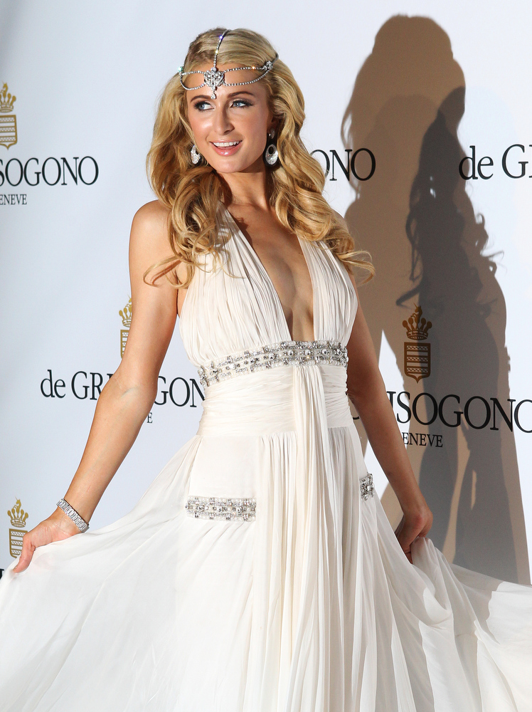 . US celebrity Paris Hilton poses for a photocall during the jewelry company de Grisogono\'s 20th anniversary cocktail, at the Eden Roc hotel, in Antibes, near Cannes, on May 21, 2013, southeastern France. JEAN CHRISTOPHE MAGNENET/AFP/Getty Images
