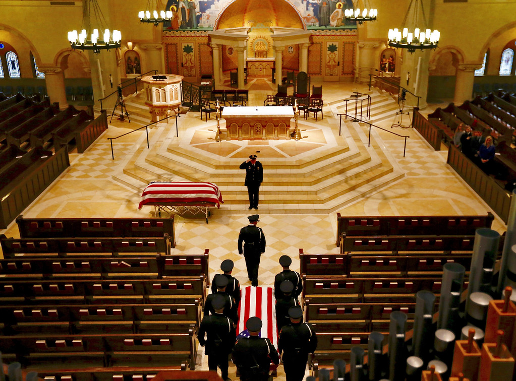 . The casket of Westerville police officer Eric Joering is brought in the church to join the casket of officer Anthony Morelli during funeral services at St. Paul the Apostle Catholic Church in Westerville, Ohio on Friday, Feb. 16, 2018.  The two veteran officers were shot after entering a residence Saturday. The officers returned fire, wounding 30-year-old Quentin Smith, who has been charged with aggravated murder and remains hospitalized.  (Jonathan Quilter /The Columbus Dispatch via AP, Pool)