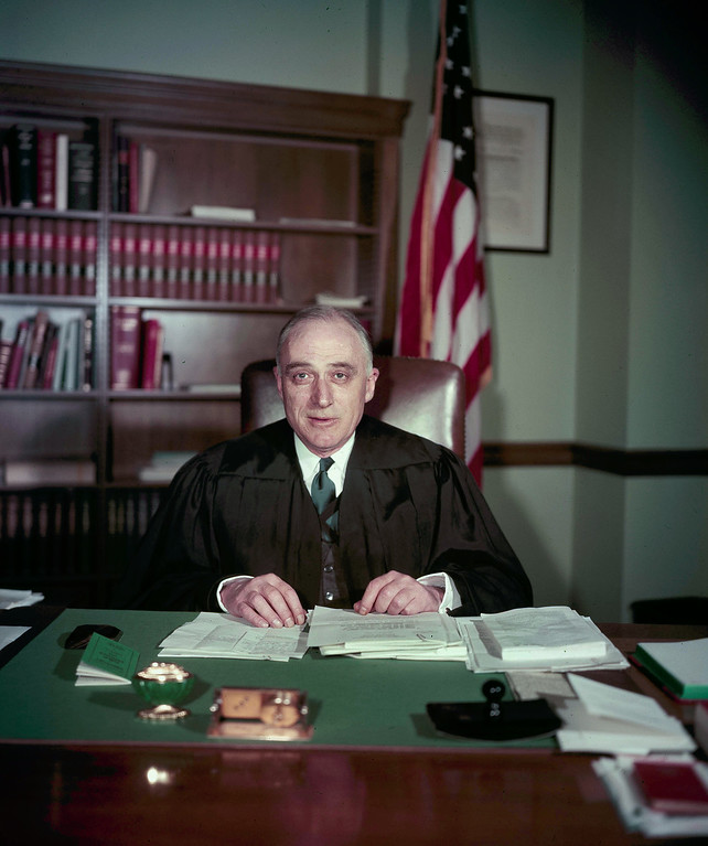 . New U.S. Supreme Court Justice John Marshall Harlan II, is shown seated at his desk in judicial robes, in Washington, D.C., March 17, 1955. (AP Photo)