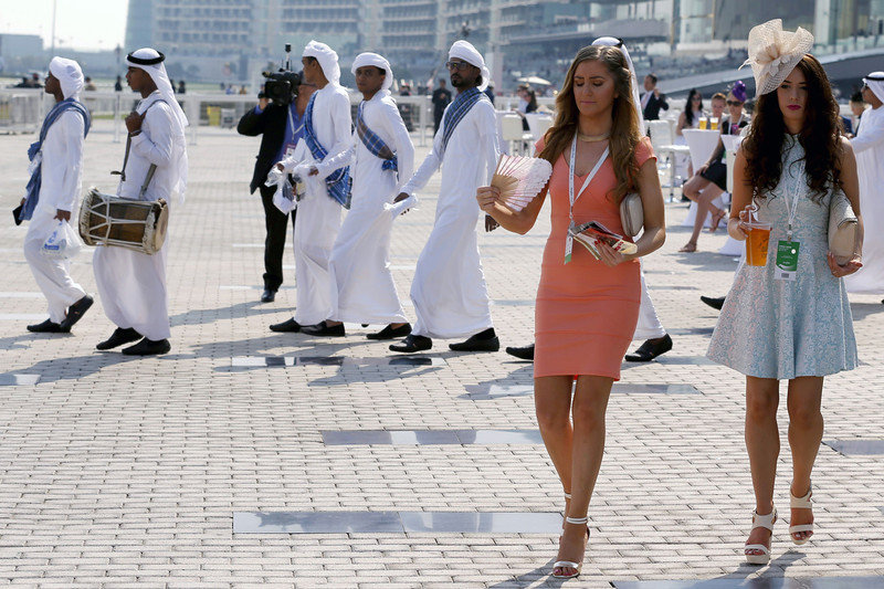 . Guests arrive at the Meydan race track before the start of the Dubai World Cup, the world\'s richest horse race with a prize money of 10 million US dollars, on March 29, 2014. (KARIM SAHIB/AFP/Getty Images)