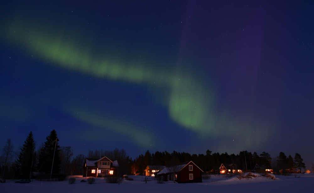 Description of . TOPSHOTS  The Aurora Borealis bright up the sky at twilight on March 17, 2013 between the towns of Are and Ostersund, Sweden.  JONATHAN NACKSTRAND/AFP/Getty Images