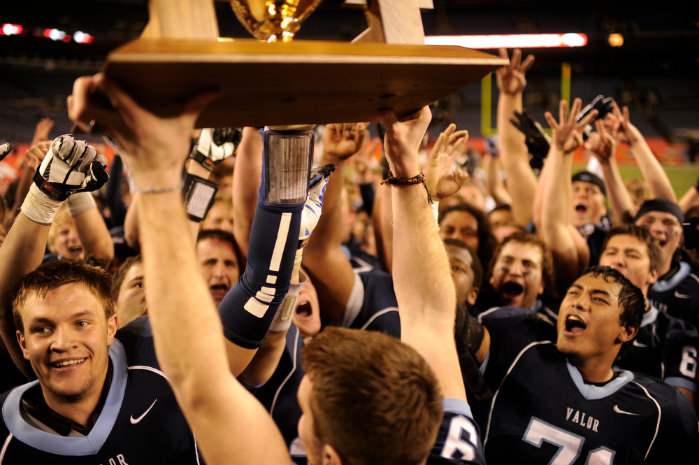 . Valor Christian players celebrate winning the 5A State Championship game against Cherokee Trail at Sports Authority Field at Mile High on Saturday in Denver, CO on December 1, 2012. Hyoung Chang, The Denver Post