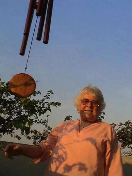 2004-2-22 5 32pm Mum with wind chime (Bangkok).jpg