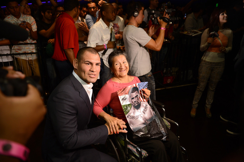 . UFC heavyweight champion Cain Velasquez says hello to a fan  during the UFC World Tour at Club Nokia Tuesday, July 30, 2013 in Los Angeles. (Hans Gutknecht/Los Angeles Daily News)