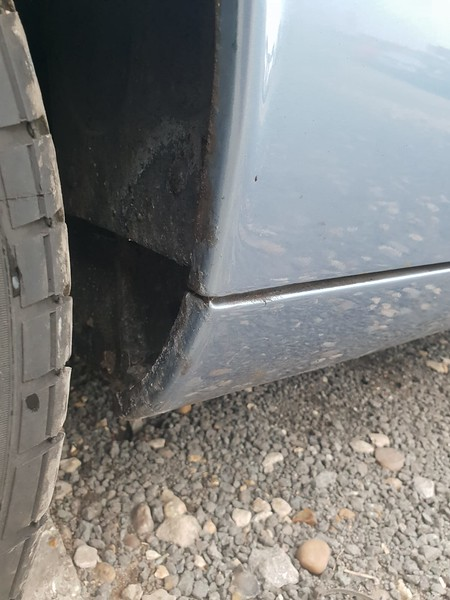 Left front wheel arch and sill lip rearward