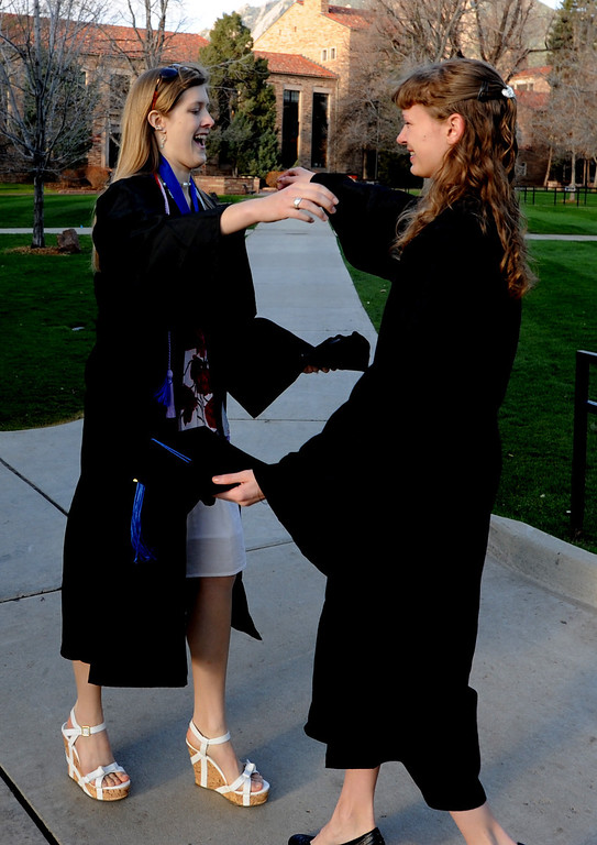 . Clementine Stowe, left, hugs Kaitlin Laflamme on Norlin Quad  before CU graduation on Friday. (Cliff Grassmick/Daily Camera)