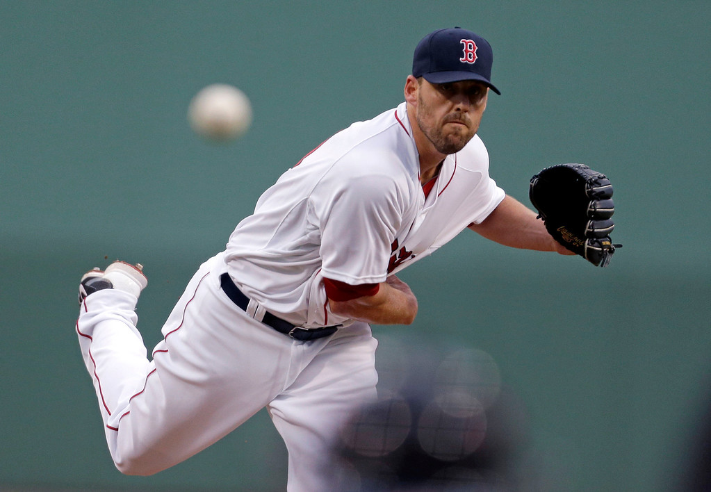 . Boston Red Sox starting pitcher John Lackey pitches in the first inning of an exhibition baseball game against the Minnesota Twins in Fort Myers, Fla., Thursday, March 27, 2014. (AP Photo/Gerald Herbert)