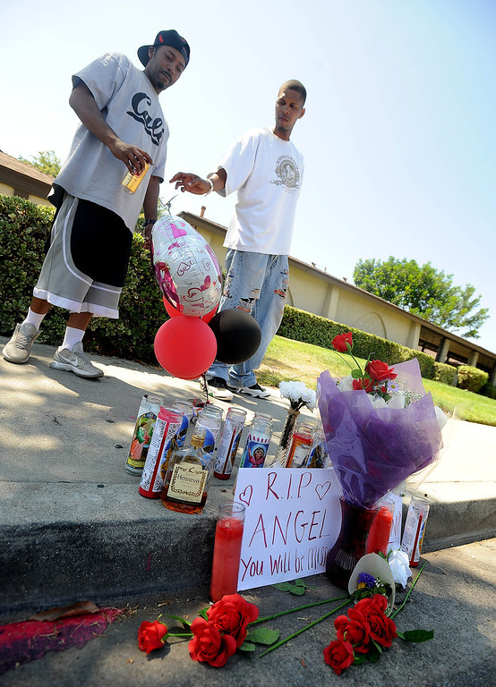 . Friends gather at a street memorial for shooting victim Angel Bravo as seen along the 1700 block of Benedict Way in Pomona August 11, 2013.   Bravo, 29, of Pomona, was killed 2:52 a.m. Sunday morning when he was shot in the street near his vehicle.  GABRIEL LUIS ACOSTA/STAFF PHOTOGRAPHER.