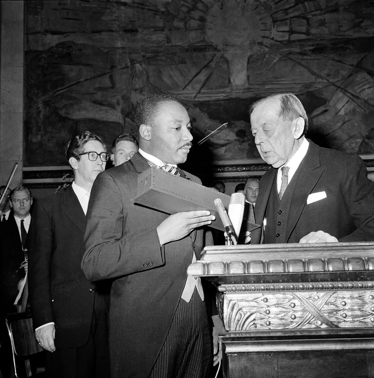 . Dr. Martin Luther King Jr.,  American civil rights leader, receives the Nobel Peace Prize from the hands of Gunnar Jahn, Chairman of the Nobel Committee, in Oslo, Norway, December 10, 1964. The 35-year-old Reverend King, the youngest man ever to receive the prize, is the 12th American and the third Black to be given the honor. (AP Photo)