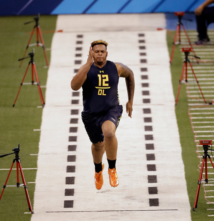. Temple offensive lineman Dion Dawkins runs the 40-yard dash at the NFL football scouting combine Friday, March 3, 2017, in Indianapolis. (AP Photo/David J. Phillip)