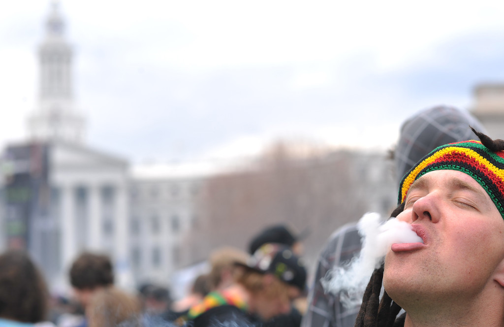 . DENVER, CO. - APRIL 20 : Cameron Kieffer, 23, of Broomfield and a crowd of marijuana smokers celebrate the counterculture holiday known as 4/20 on the first celebration since Colorado and Washington made pot legal for recreation use. (Photo By Hyoung Chang/The Denver Post)
