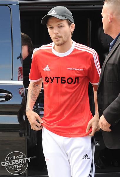 Louis Tomlinson In Russian Gosha Rubchinskiy Adidas X Football Shirt