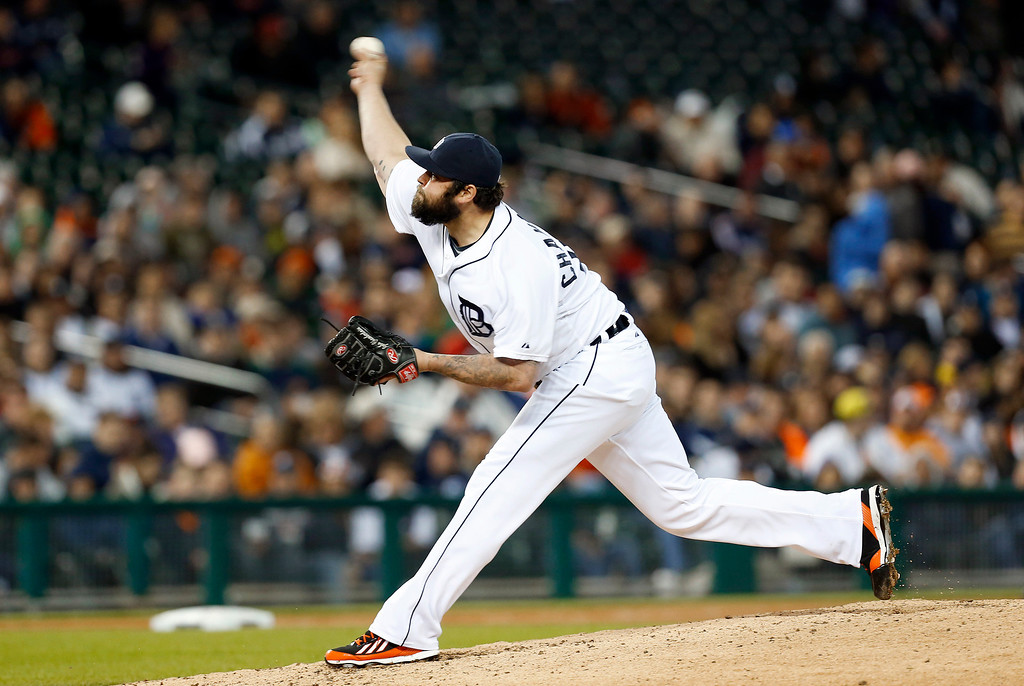 . Detroit Tigers relief pitcher Joba Chamberlain throws against the Houston Astros in the seventh inning of a baseball game in Detroit, Wednesday, May 7, 2014. (AP Photo/Paul Sancya)