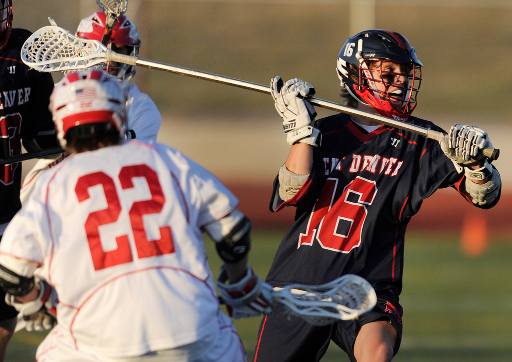 . AURORA, CO. - APRIL 24:  Sun Devils defenseman Jack Ammons (16) worked in front of his net in the first half. The Regis Jesuit High School boy\'s lacrosse team defeated Kent Denver 10-8 Wednesday night, April 24, 2013. Photo By Karl Gehring/The Denver Post